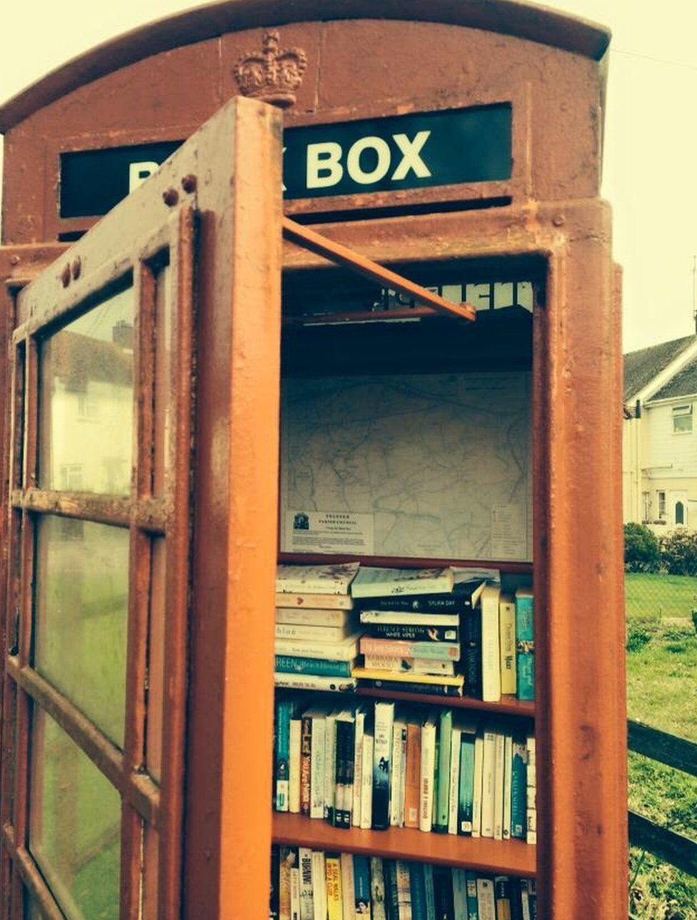 A phone box used as a library in Felsted, Essex