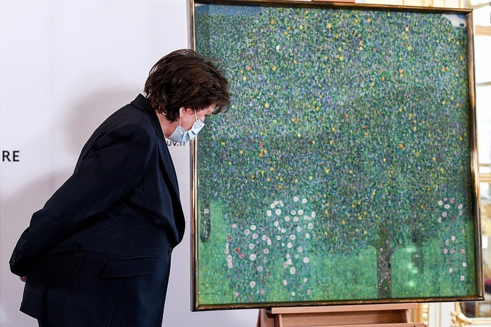 French Culture Minister Roselyne Bachelot stands next to the painting Rose Bushes under the Trees by Austrian painter Gustav Klimt, at the Musee d'Orsay in Paris, France March 15, 2021