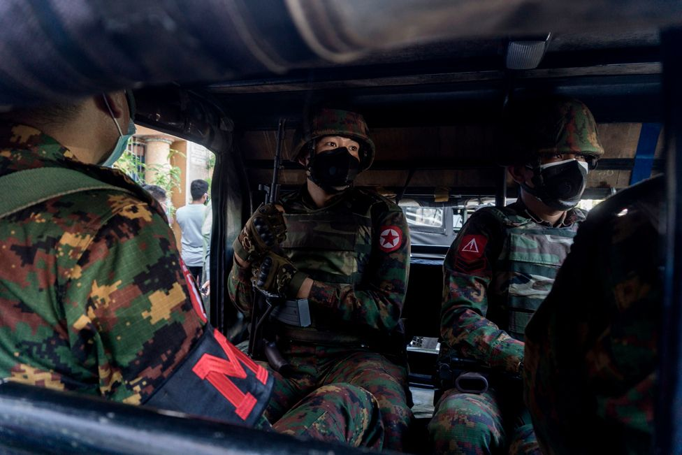Soldiers sit inside a military truck outside a Hindu temple in Yangon, Myanmar, on 2 February 2021