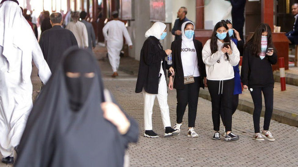Women walk through a market in Kuwait City (file photo)