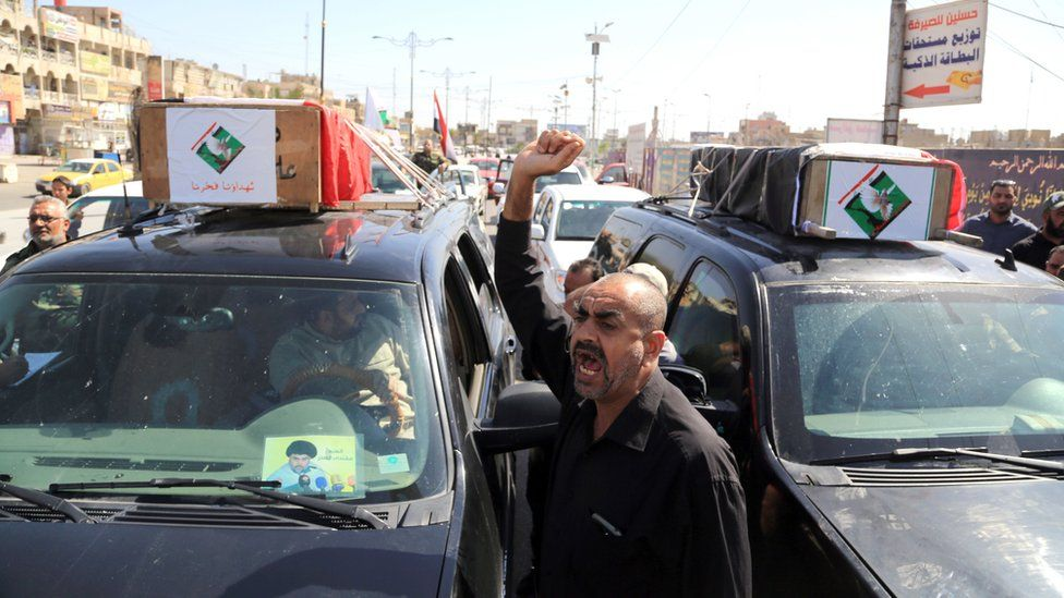 "Mourners carry the Iraqi flag-draped coffins of two protesters killed in the protests outside Baghdad""s highly fortified Green Zone on Friday, during their funeral procession in Baghdad, Iraq. Saturday, May 21, 2016."