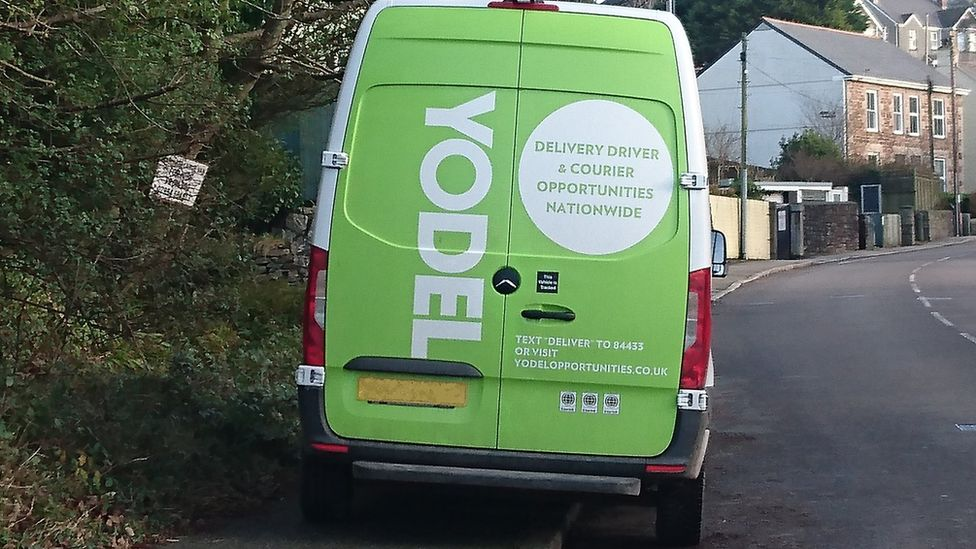 Yodel van parked on path