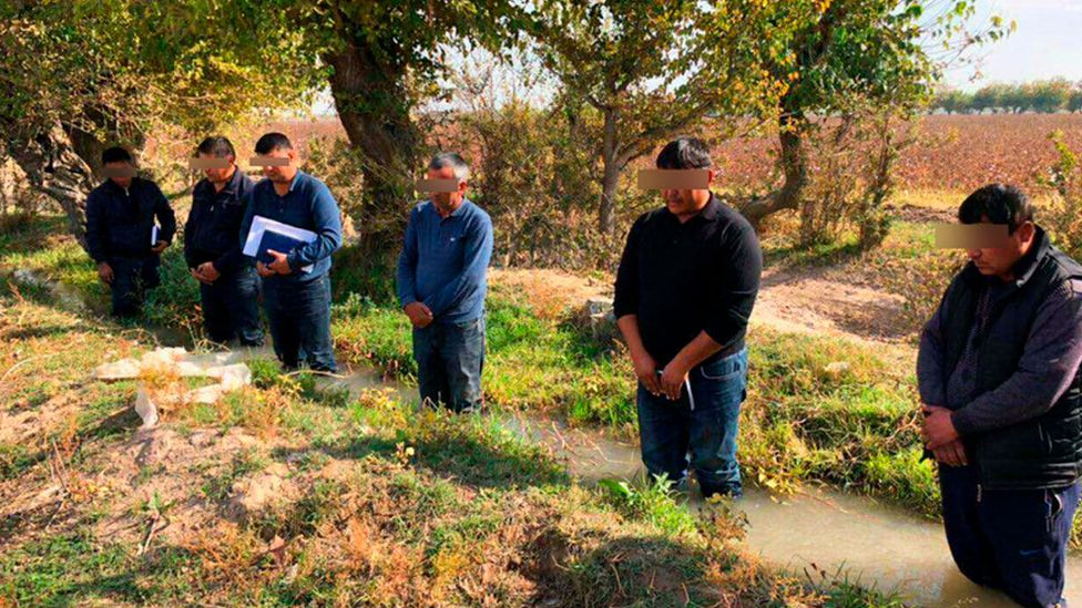 Six Uzbek men made to stand in irrigation ditch, October 2018