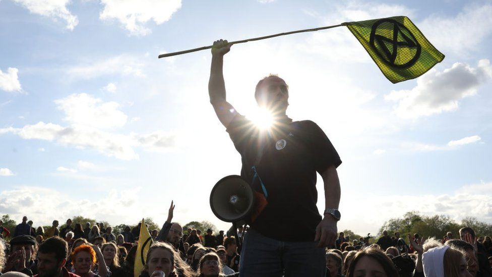 protester waving flag