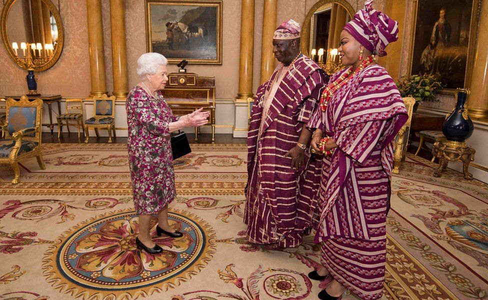 Queen Elizabeth II of the UK greets Nigeria's ambassador to the UK George Adesola Oguntade and his wife during a Modupe Oguntade during a private audience at Buckingham Palace in central London, UK - Wednesday 6 December 2017