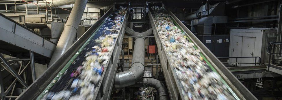 Conveyor belts transport plastic waste at the ALBA Group recycling plant in Berlin, Germany