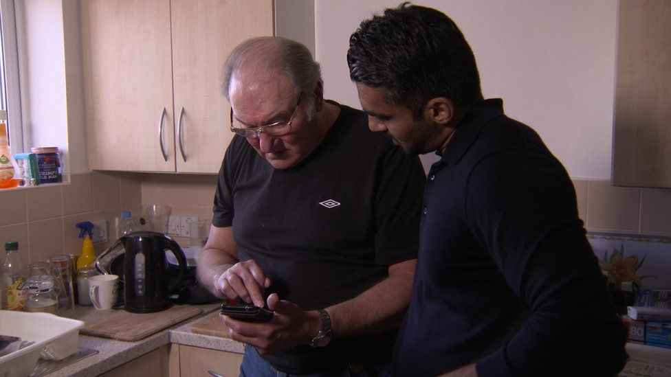 Catfish victim Roy showing reporter Athar Ahmad conversations he had with someone pretending to be someone else.