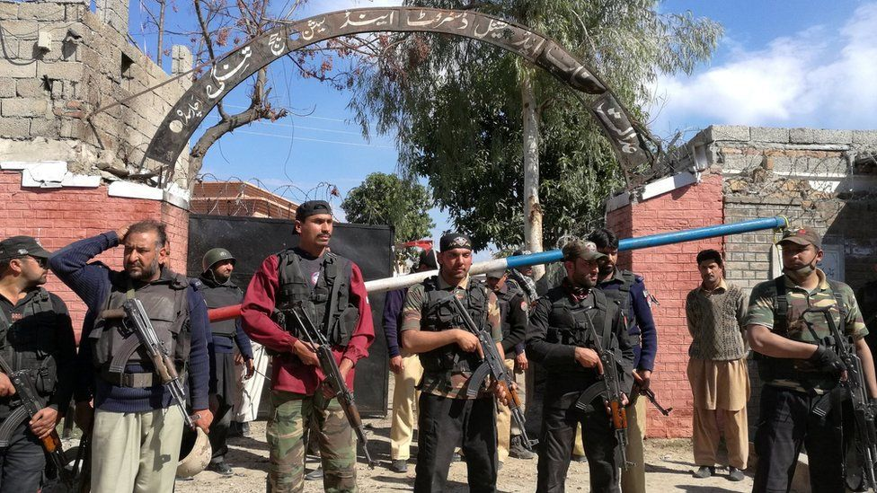 Policemen stand guard outside the courthouse in Charsadda, Pakistan, on 21 February 2017