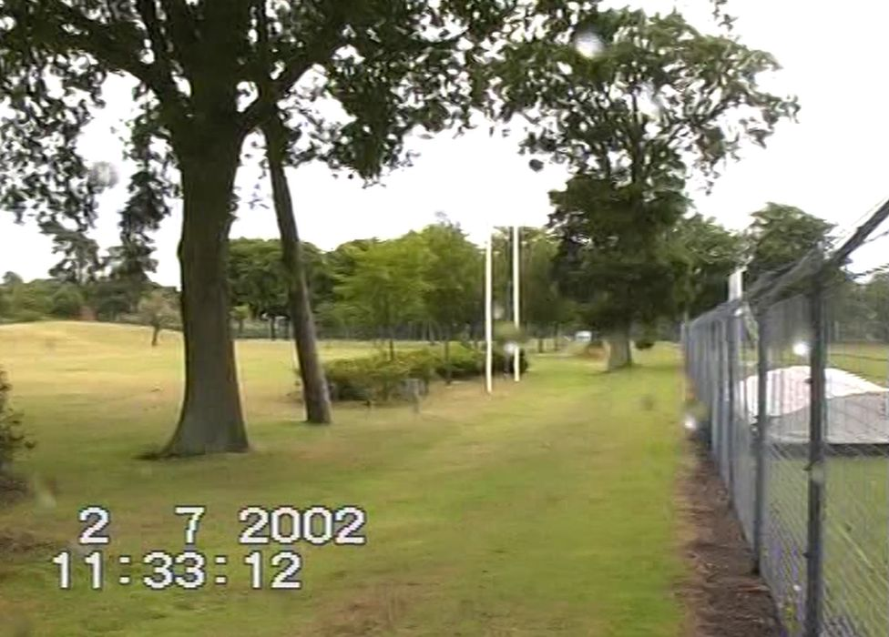 Photograph taken in 2002 showing the view along the perimeter fence line looking towards the tree under which Geoff was found