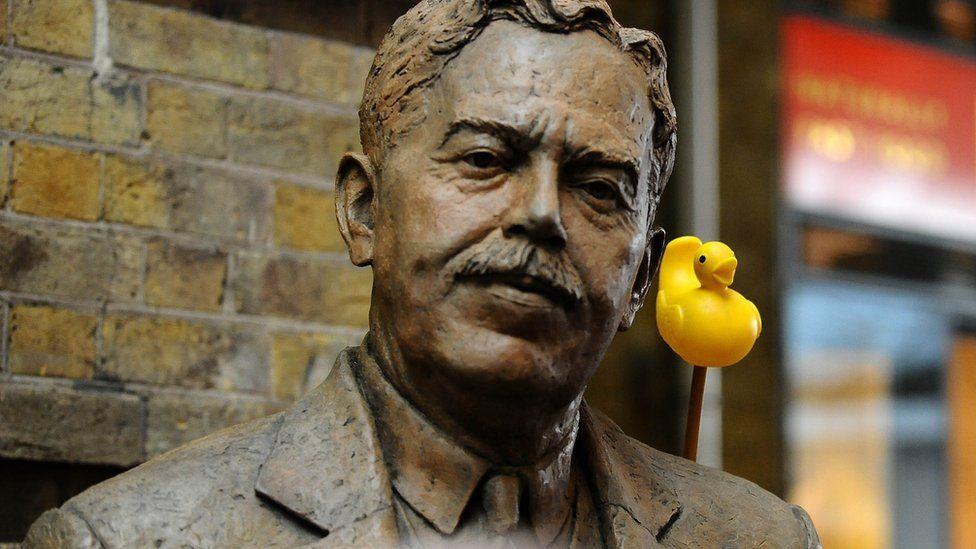 A rubber duck behind the shoulder of Sir Nigel Gresley's statue