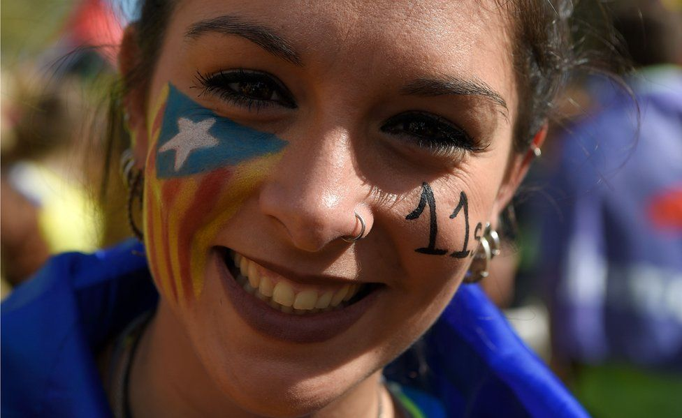 Woman with Catalan flag painted on her face, 11 Sep 17