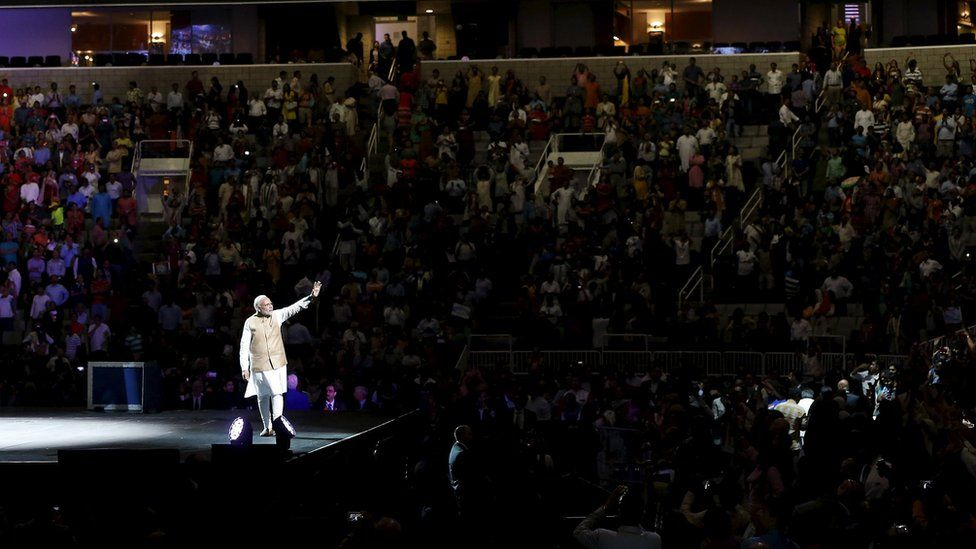 Indian Prime Minister Narendra Modi waves to the crowd after speaking at a community reception at SAP Center in San Jose