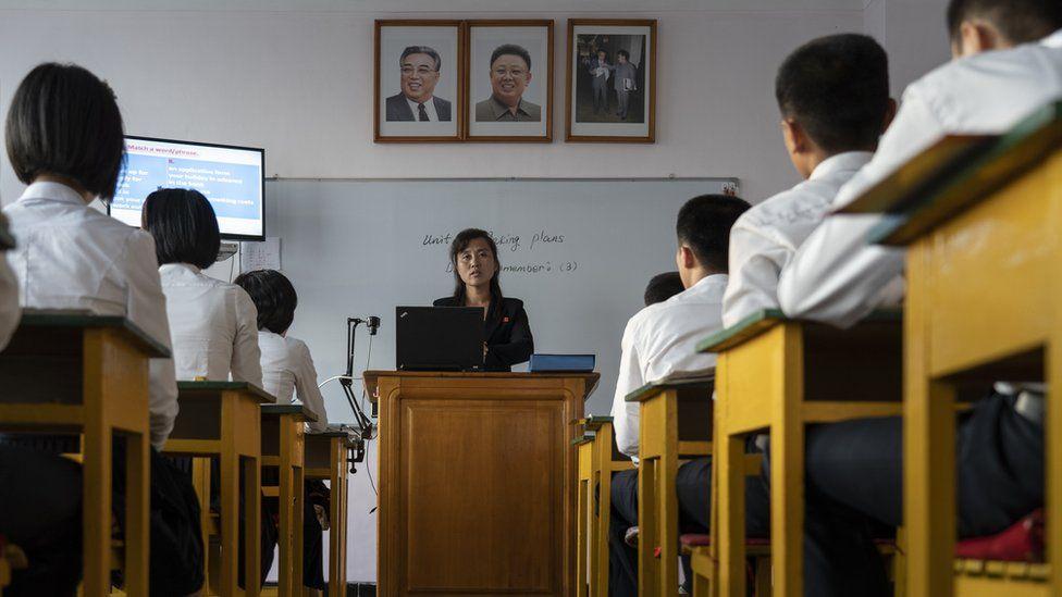 A teacher in front of her class