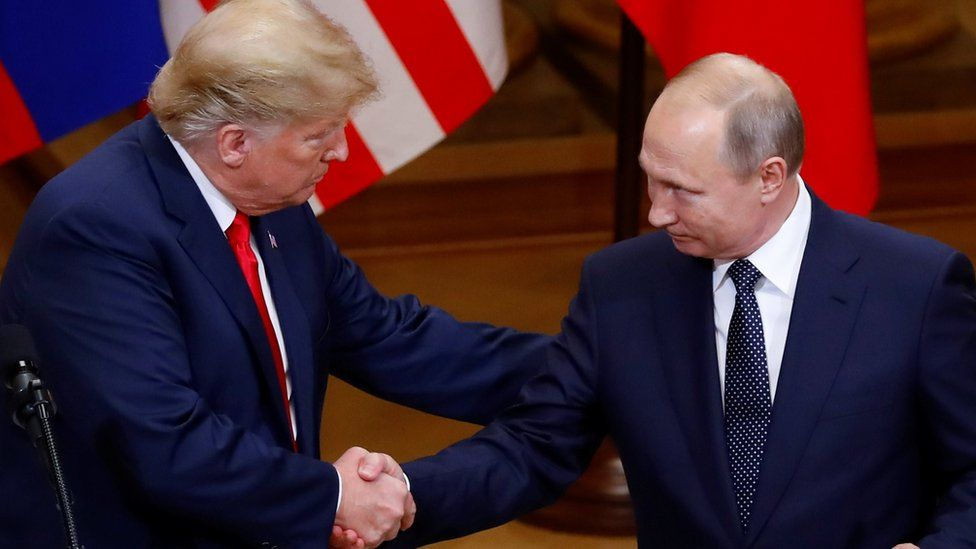 US President Donald Trump and Russian President Vladimir Putin shake hands as they hold a joint news conference after their meeting in Helsinki, Finland, July 16, 2018