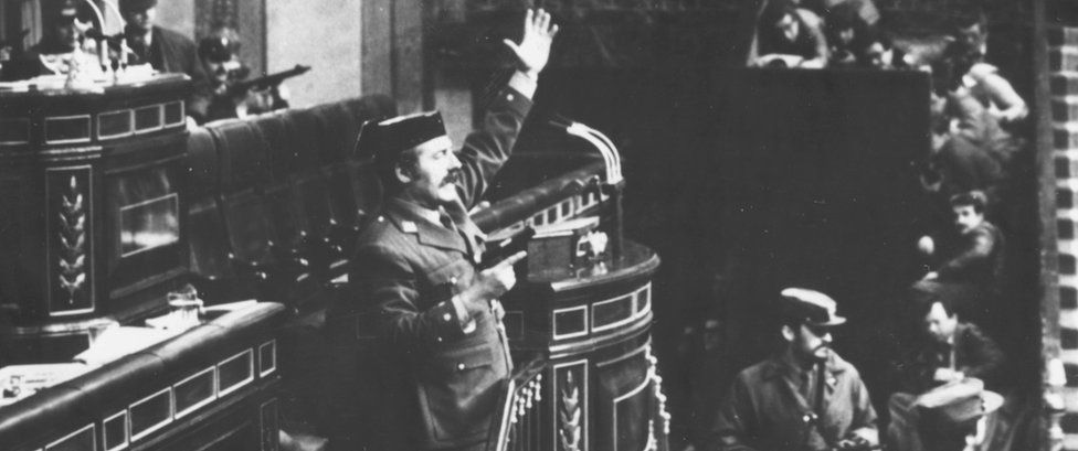 Colonel Antonio Tejero brandishing a gun as he attempts to take over Spanish parliament in a coup (Feb 1981)