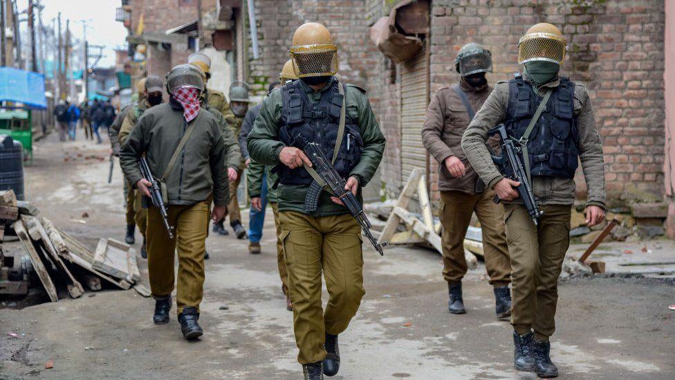 Indian policemen patrolling during clashes in Srinagar.