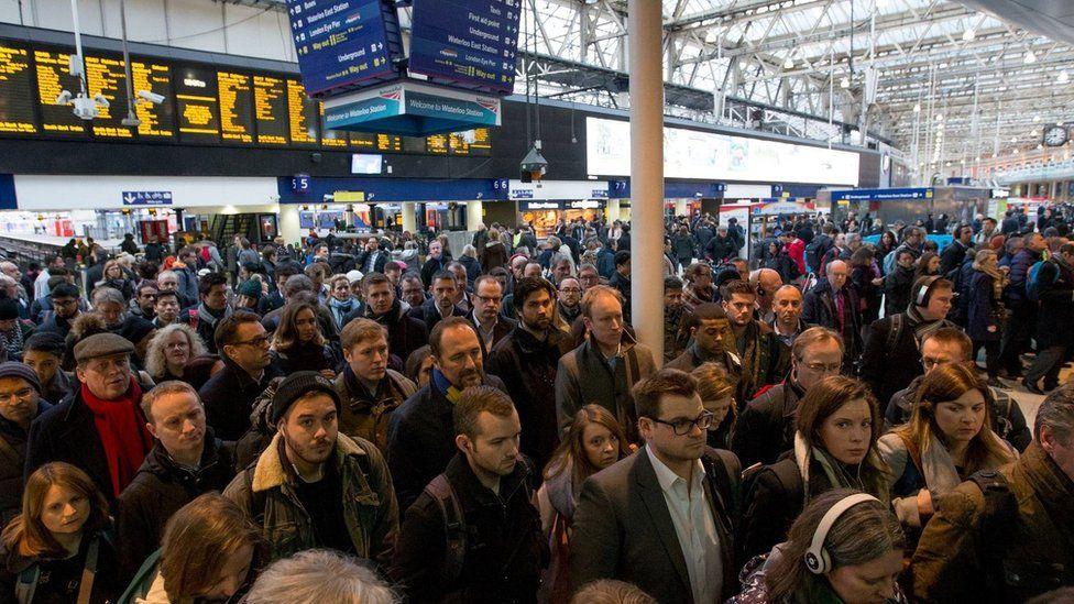Passengers queue at London Waterloo