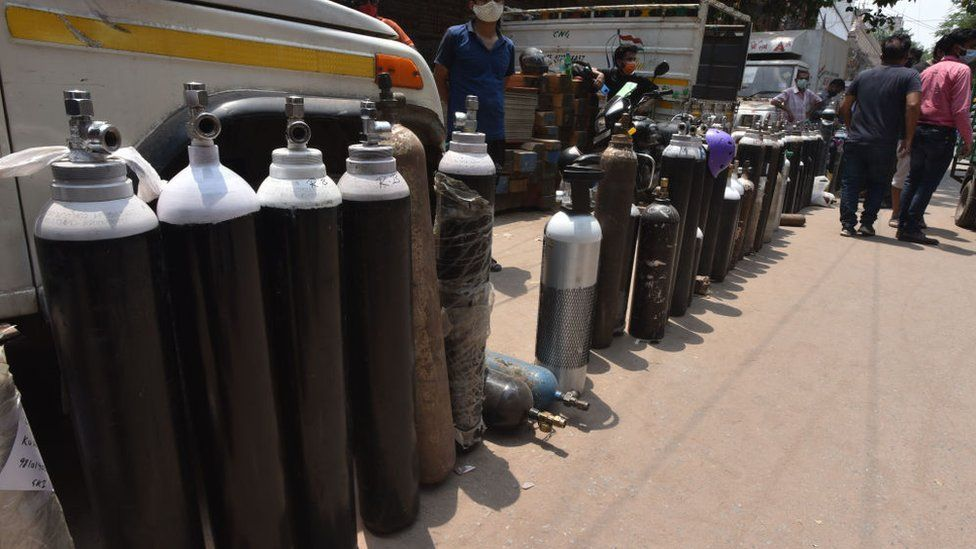 Family members of Covid patients stand in long queue with empty oxygen cylinders outside the oxygen filling center to get their oxygen cylinders replenished at Bhogal Jangpura, on May 1, 2021 in New Delhi, India.