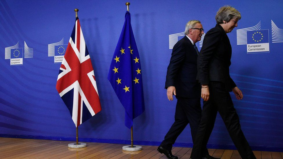 EU Commission President Jean-Claude Juncker and Prime Minister Theresa May