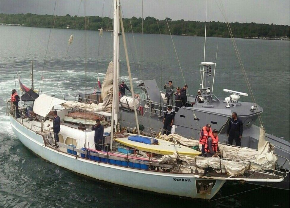 "In this photo provided by the Armed Forces of the Philippines Western Mindanao Command (WESMINCOM) on 7 November 2016, Philippine Navy staff are seen boarding the yacht ""Rockall"" after being found abandoned off the Sulu Sea in southern Philippines."