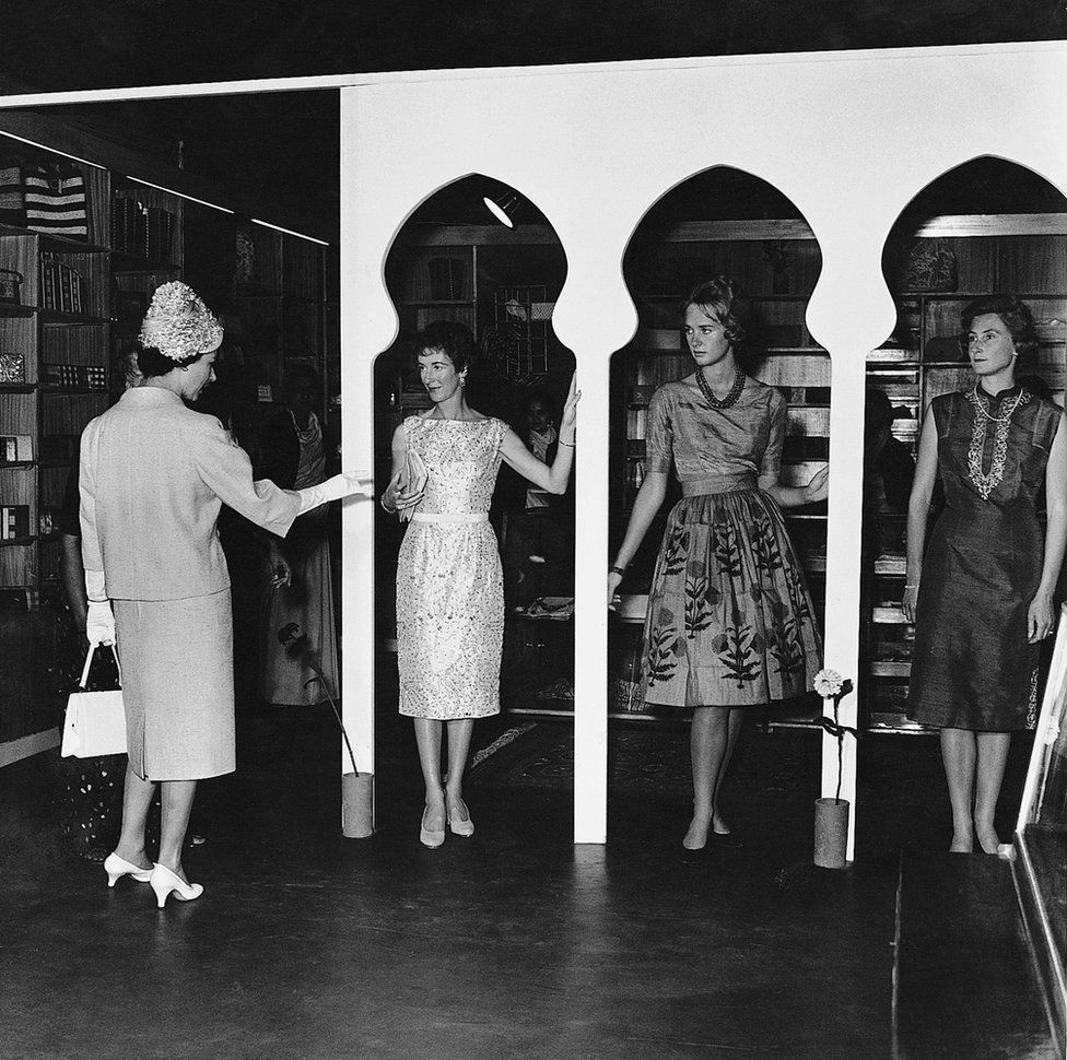 Queen Elizabeth II at a fashion show organized by the wives of diplomats in Delhi in 1961