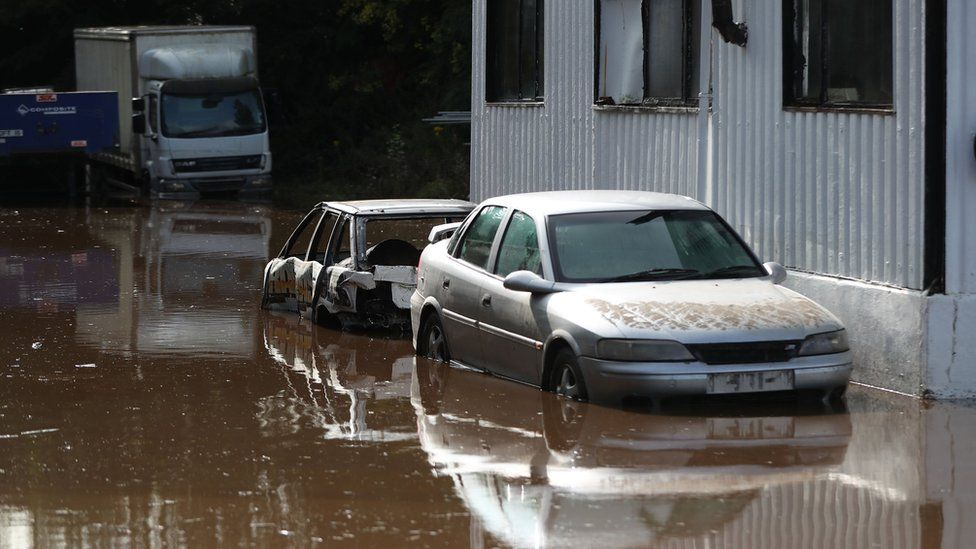 Cars submerged in water as the River Dennet in Londonderry burst its banks