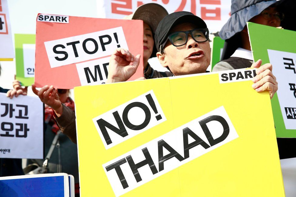 South Korean protesters display placards during a rally held to demand the removal of the US military's Terminal High Altitude Area Defense (THAAD) system, near the US embassy in Seoul, South Korea, 28 April 2017.