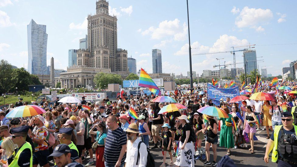 People participate in the Gay Pride parade in Warsaw, Poland