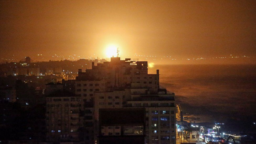Smoke and flames rise following an Israeli air strike in the southern Gaza Strip (13 September 2021)
