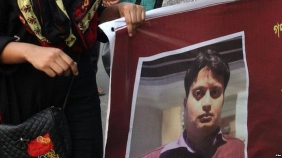 Mourner with a poster of Ananta Bijoy Das