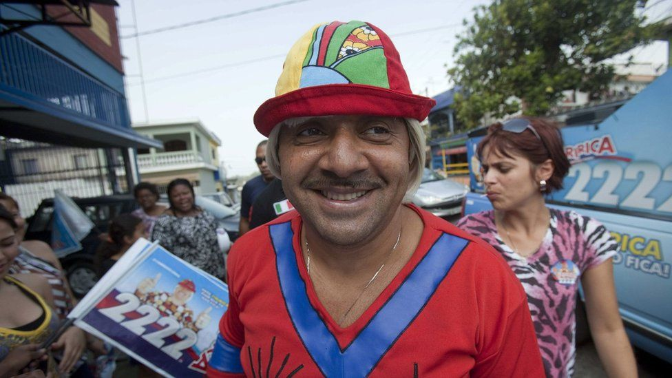 Brazilian Clown Tiririca Candidate to Federal Deputy For the Republic Party (pr) Participates in a Campaign Event in a Neighborhood in Sao Paulo Brazil 23 September 2010
