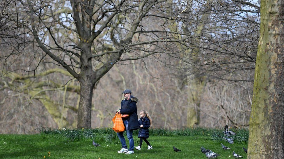 """Members of the Public walk round St James""""s Park on March 21, 2020 in London, England"""