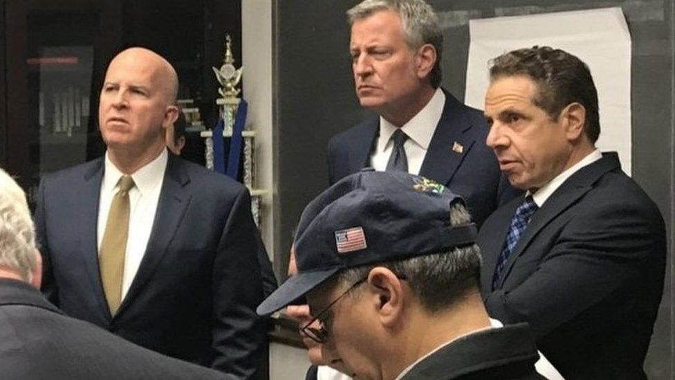 NYPD Commissioner James O'Neill (left), New York City Mayor Bill de Blasio (centre) and New York Governor Andrew Cuomo (right) discuss the incident