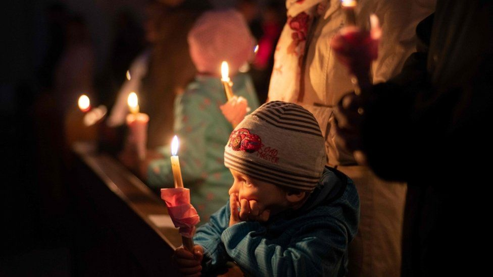Worshippers held candles at a service in Bratislava, Slovakia