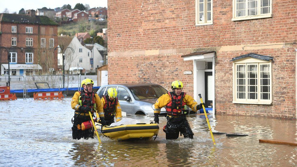 Fire and Rescue officers use an inflatable raft in Bewdley, Worcestershire