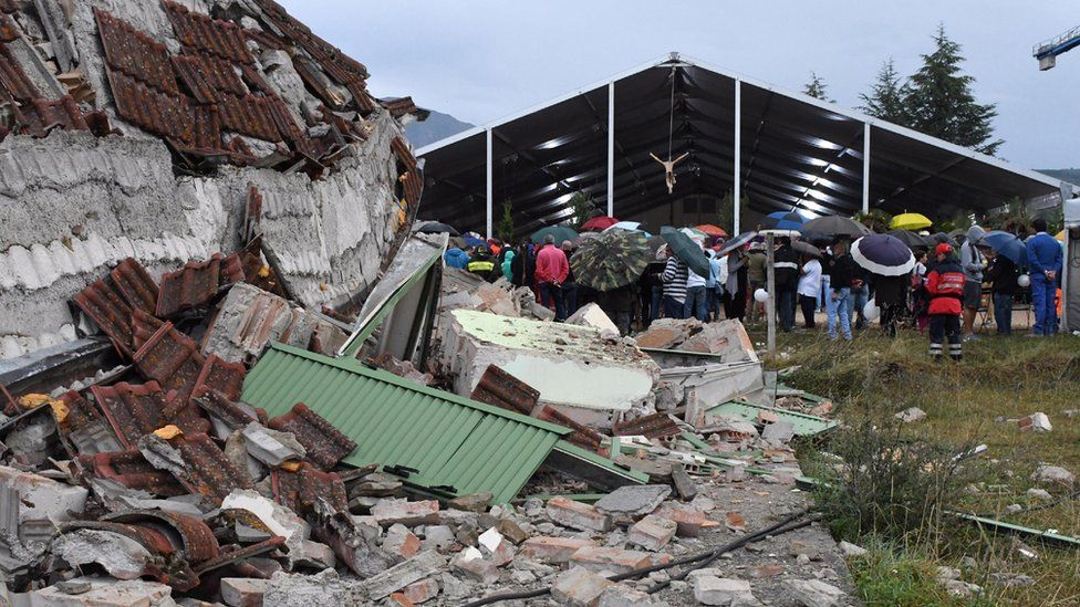 Debris next to the marquee hosting a state funeral for victims of earthquake in Amatrice, central Italy, Tuesday, Aug. 30, 2016