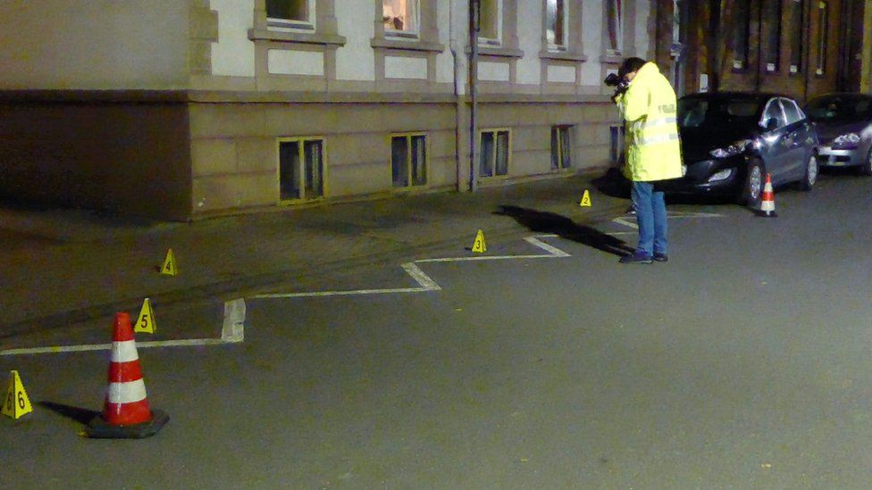 Police examine a street in Hamelin, Germany, on 21 Nov 2016 after a woman is found seriously injured