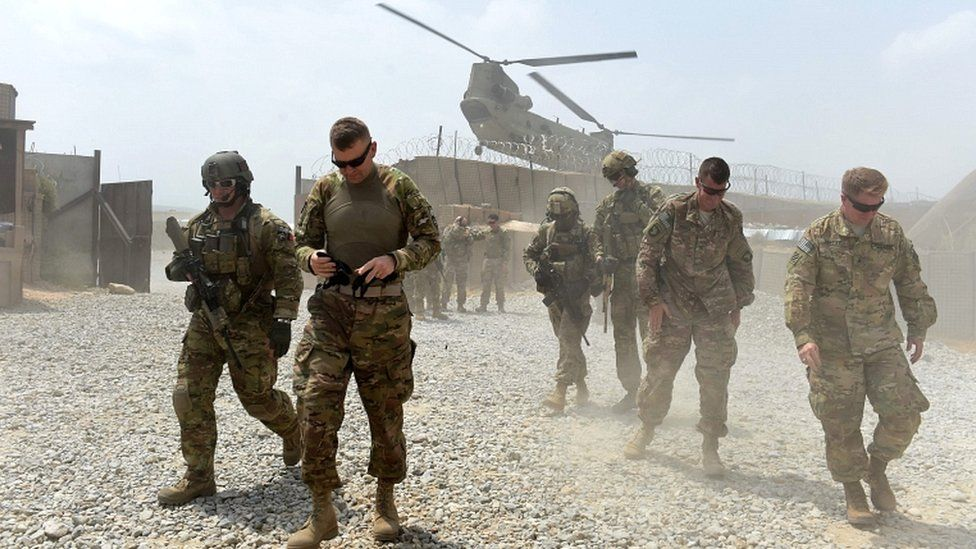 US army soldiers walk as a Nato helicopter flies overhead at coalition force Forward Operating Base (FOB) Connelly in the Khogyani district in the eastern province of Nangarhar, Afghanistan (2015 file picture)