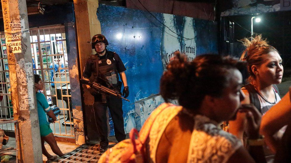 A Federal Police officer stands at the entrance of a bar where a man was shot dead by gunmen, in Acapulco, Mexico on July 16, 2016.