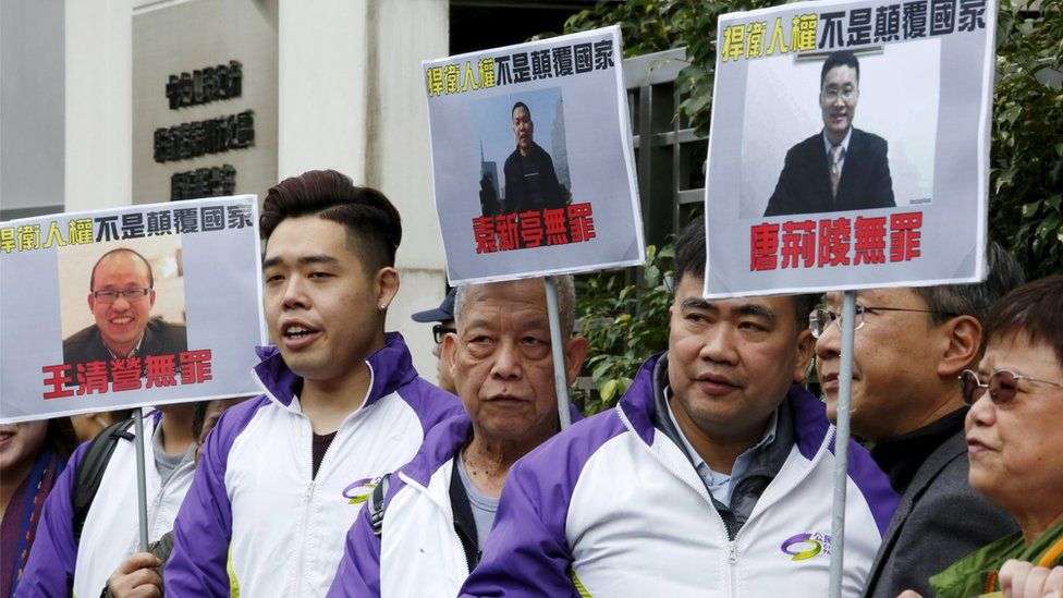 "Members from Civic Party, holding portraits of (L-R) Wang Qingying, Yuan Chaoyang and Tang Jingling, protest outside China""s Liaison Office in Hong Kong, China, January 29, 2016"
