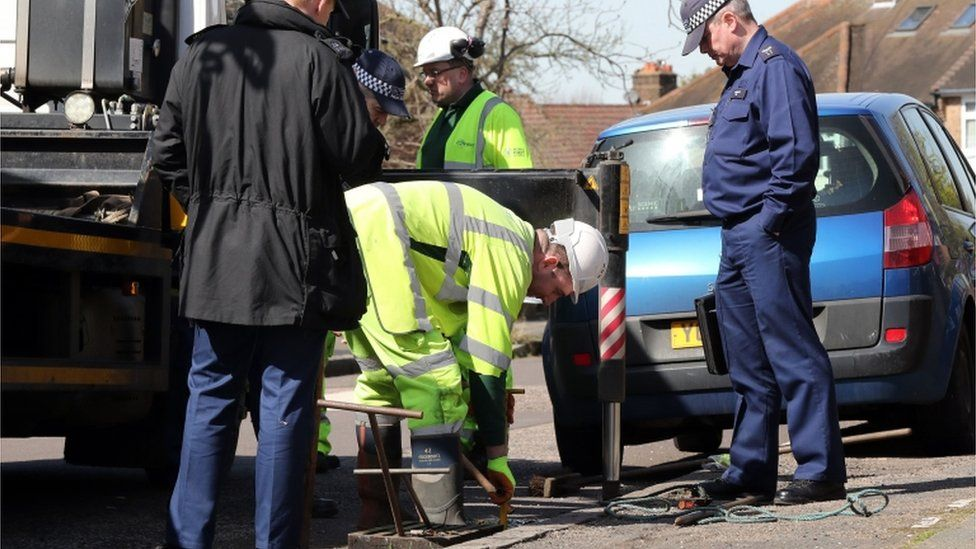Forensic officers investigate the drains near the scene in South Park Crescent in Hither Green