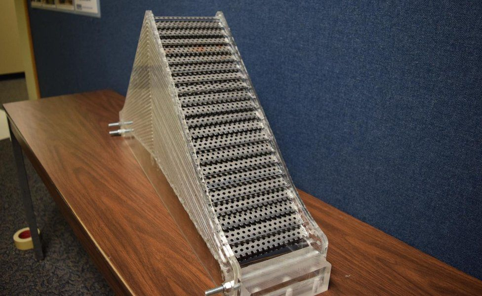 Prototype cloaking device made of out of perforated steel plates.