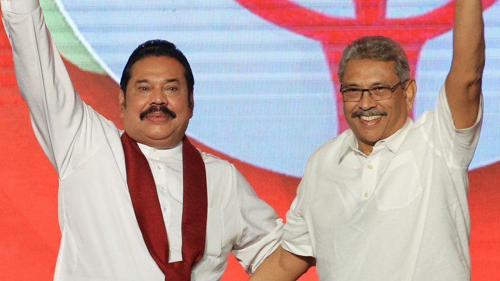 Sri Lankan opposition leader and former president Mahinda Rajapaksa (L) and former defence secretary Gotabaya Rajapaksa