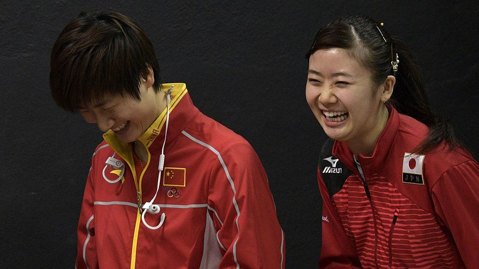 Olympic table tennis players Ai Fukuhara (R) of Japan and Ning Ding of China share a laugh following a press conference at Riocentro complex in Rio de Janeiro