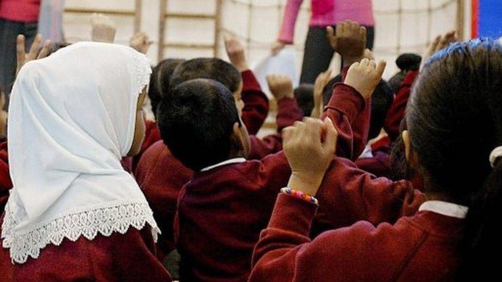 A schoolgirl wearing a hijab