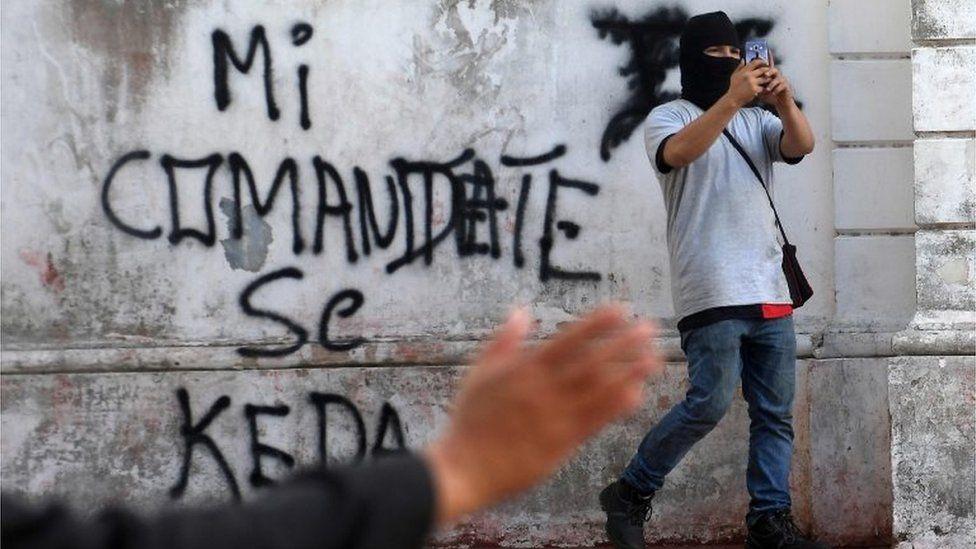 A supporter of under-pressure Nicaraguan President Daniel Ortega films outside the San Sebastian Basilica in Diriamba, Nicaragua, on July 9, 2018