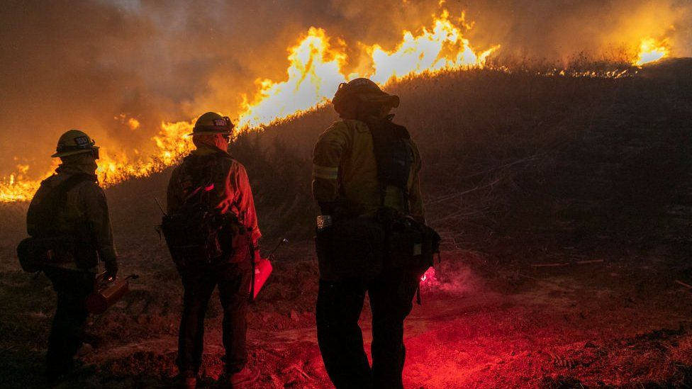 Firefighters set a backfire to protect homes and try to contain the Blue Ridge Fire on October 27, 2020