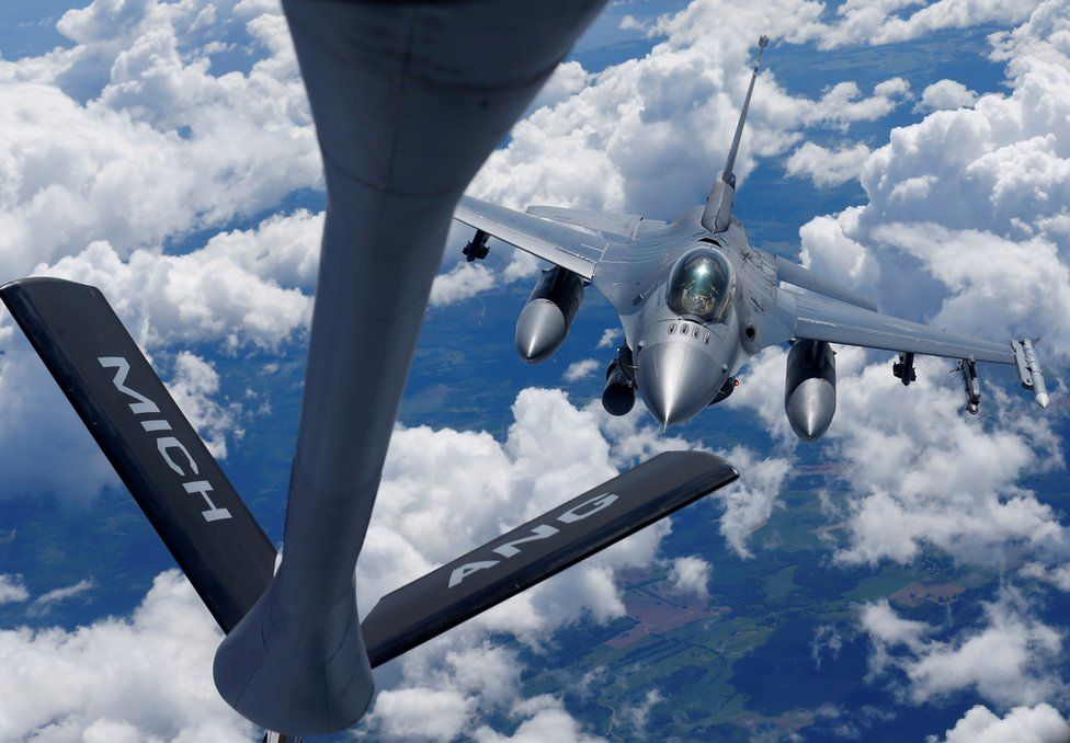 A US Air Force F-16 fighter approaches a KC-135 aerial refuelling aircraft during the US led Saber Strike exercise in the air over Estonia June 6, 2018