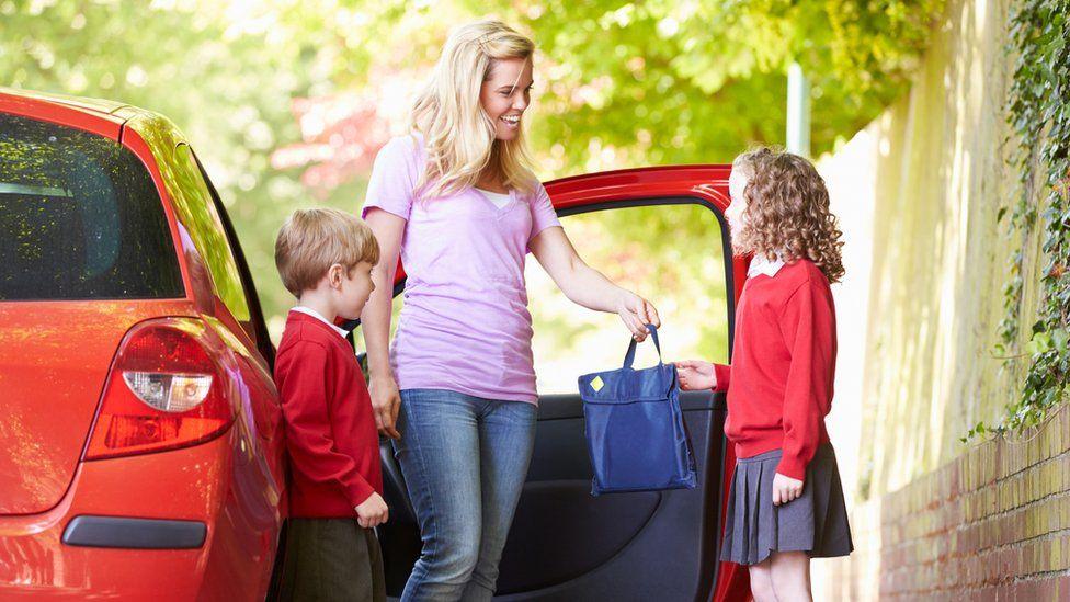 Woman with schoolchildren