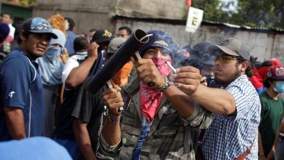 Demonstrators fire a homemade mortar in Masaya, Nicaragua, June 18, 2018.